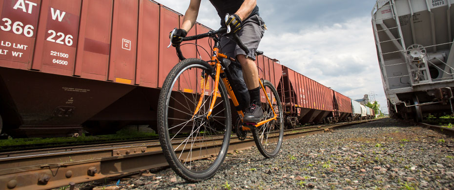 Cross-Check riding image next to railroad tracks