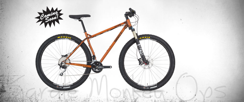 Surly Karate Monkey Ops bike - orange - right side view - faded white background with a
