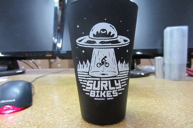 Front view of a Surly Bikes pint glass, black
