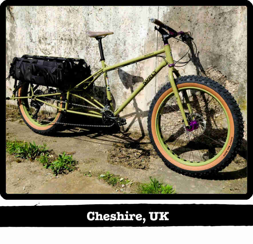 Right side view of a Surly Big Fat Dummy bike, green, against a concrete wall - Cheshire, UK tag below image
