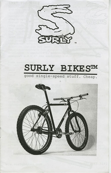 Surly Bikes 1999 catalog cover - black text, with rear, right side image of a bike - black & white