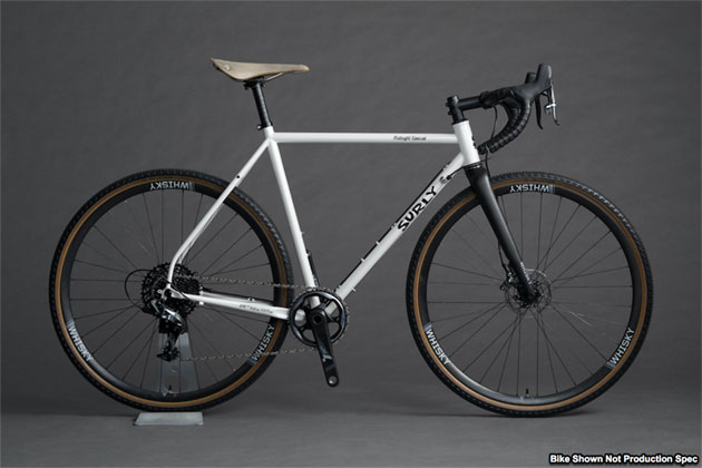 Right profile view of a Surly Midnight Special bike, white, with Whisky forks, against a gray background