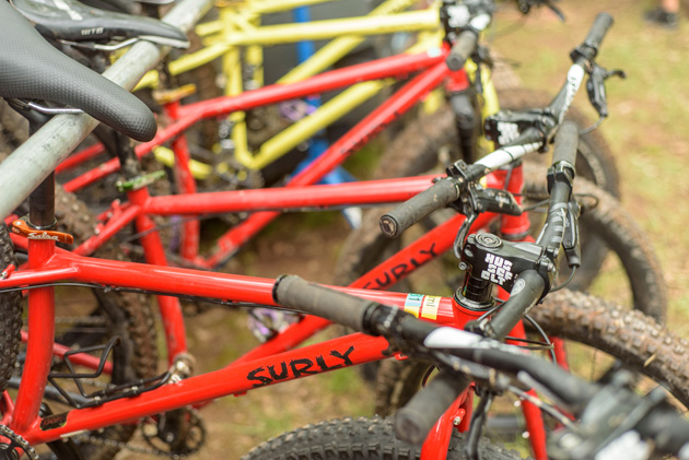 Right side view of red Surly bikes lined up
