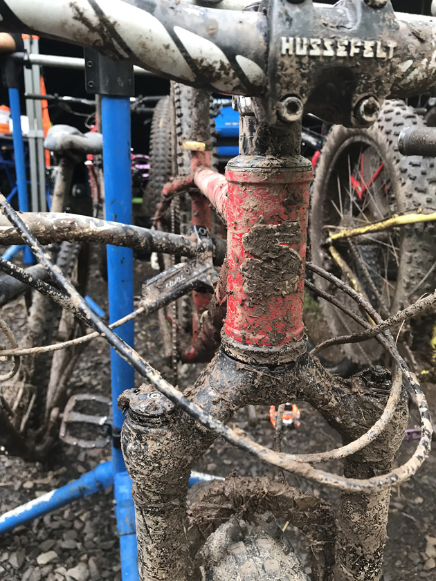Front view of bike with a muddy headset and fork
