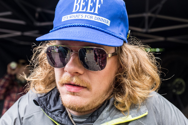 Sweet Beef with a blue baseball cap with mirrored sunglasses wearing a gray jacket