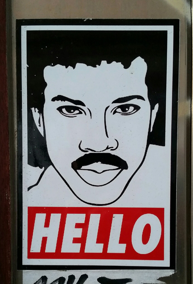 Poster sign drawing of Lionel Richie looking straight ahead with the word 'HELLO' underneath