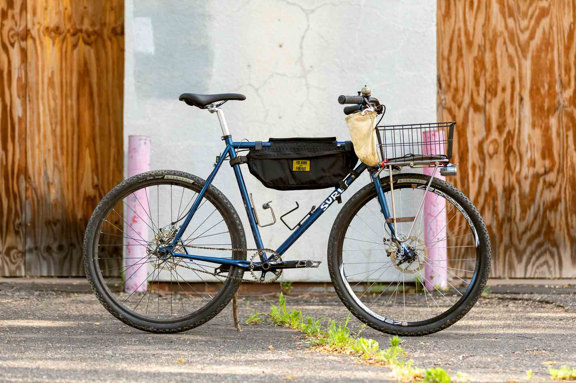 Make It Your Own - Surly Straggle Rat custom bike build using blue Surly Straggle frameset, single speed with front rack/ basket