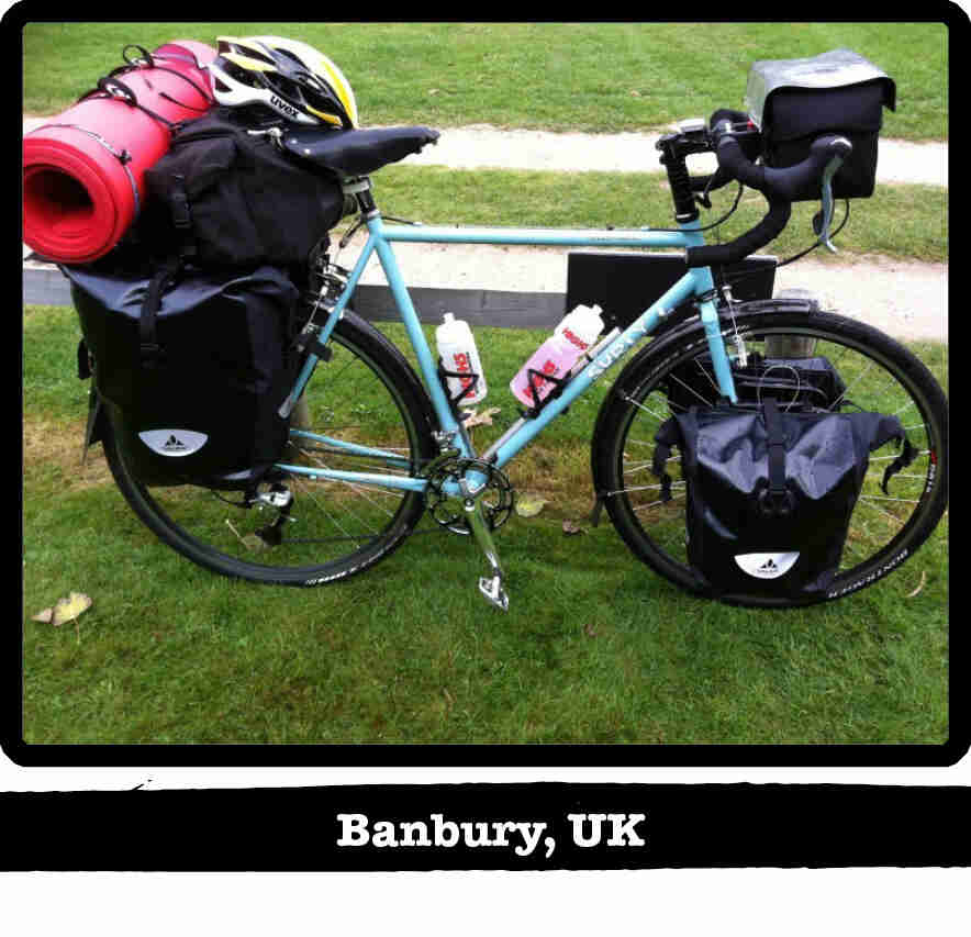Right side view of a mint Surly bike, full of gear, standing on short green grass - Banbury, UK tag below image