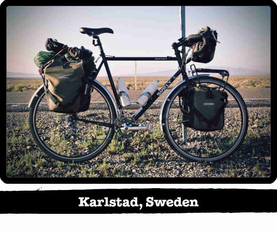 Right side view of Surly bike loaded with gear, on the shoulder of a remote road - Karlstad, Sweden tag below image