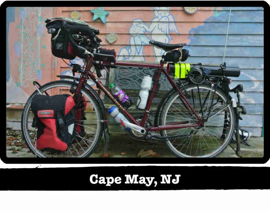 Left view of a dark red Surly bike with gear, in front pf a mural painted wall - Cape May, NJ tag below image