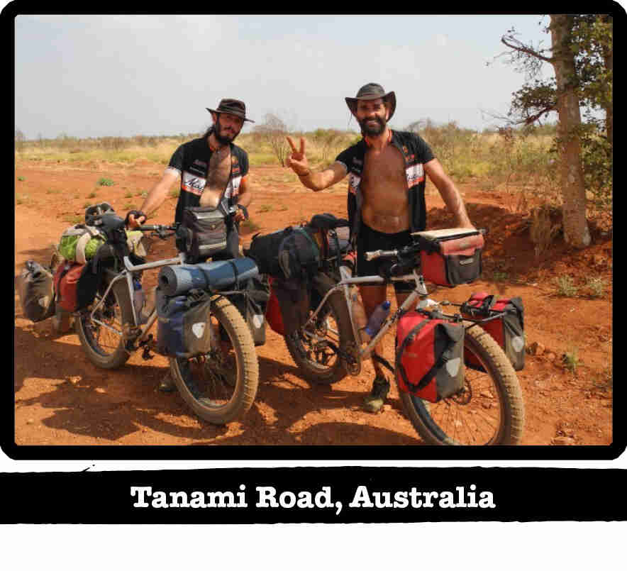 Two cyclists standing next to their Surly fat bikes in the outback - Tanami Road, Australia