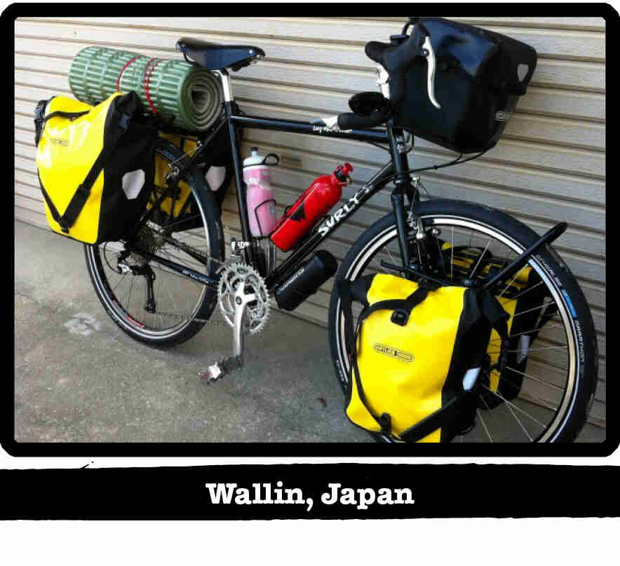 Right side view of a black Surly bike loaded with gear, leaning on a steel sided wall - Wallin, Japan tag below image