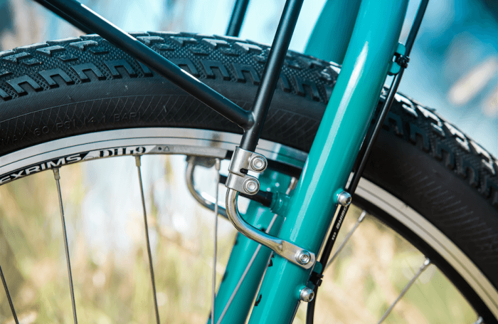 Surly 8-Pack rack - black - mounted on a turquoise Surly bike - lower fork mount detail - left side view