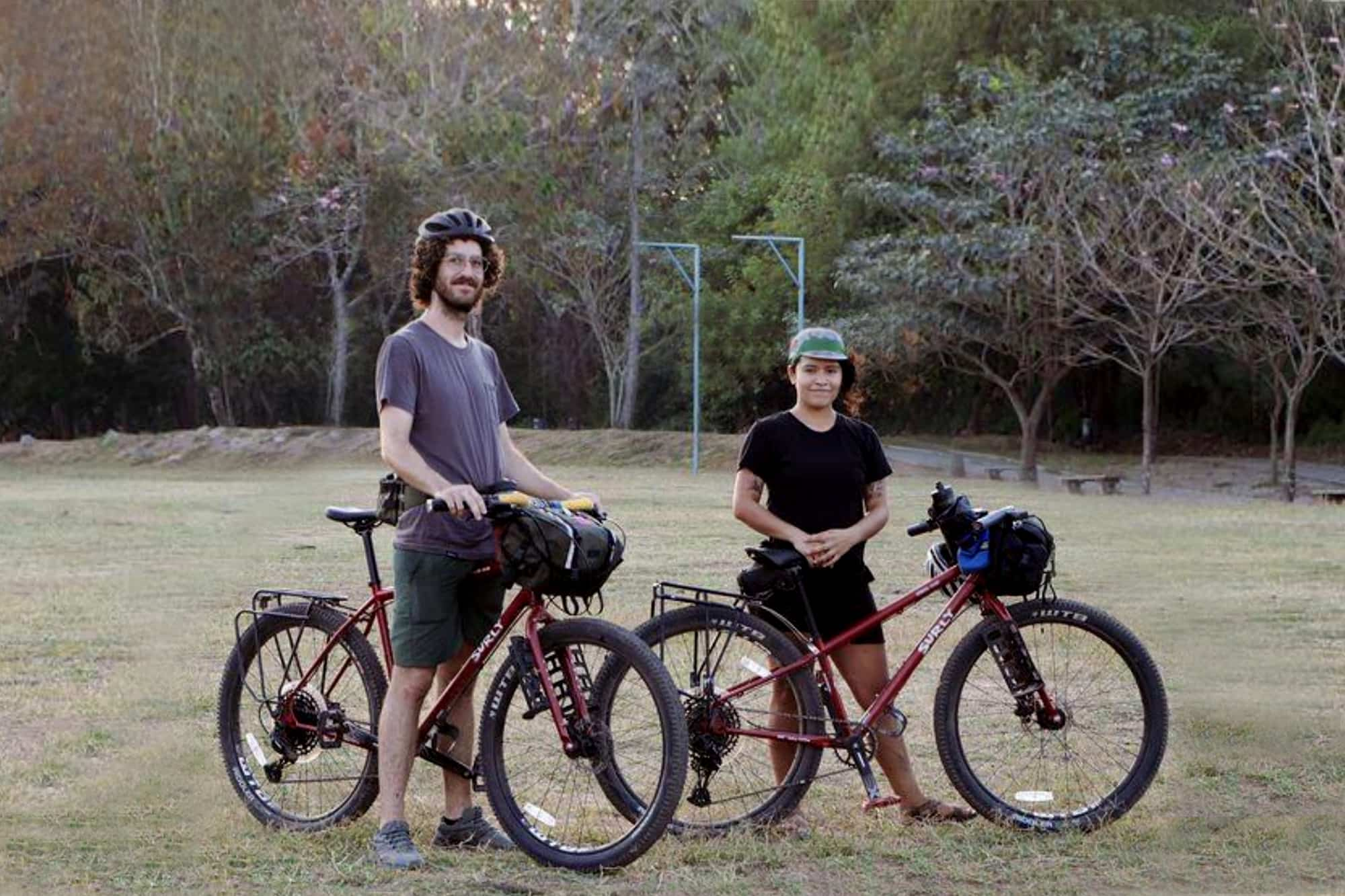 Andrea and Jake with their red Surly Bridge Clubs