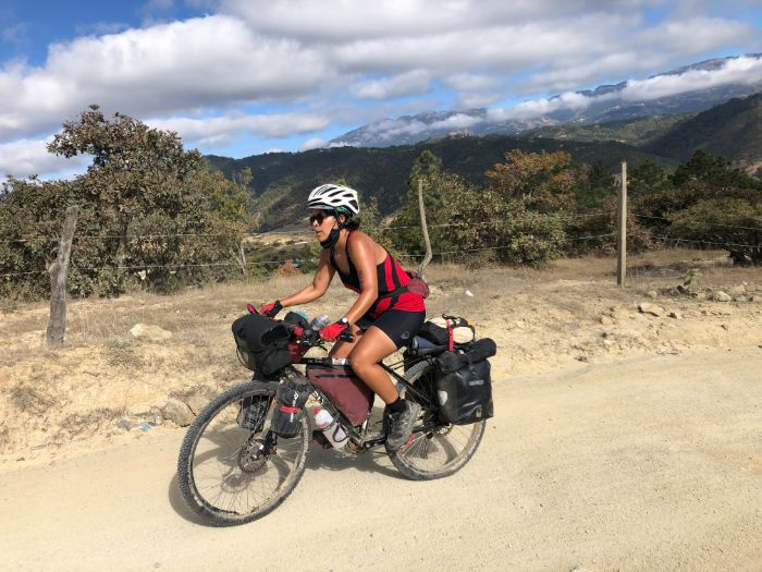 Andrea riding with mountains behind her