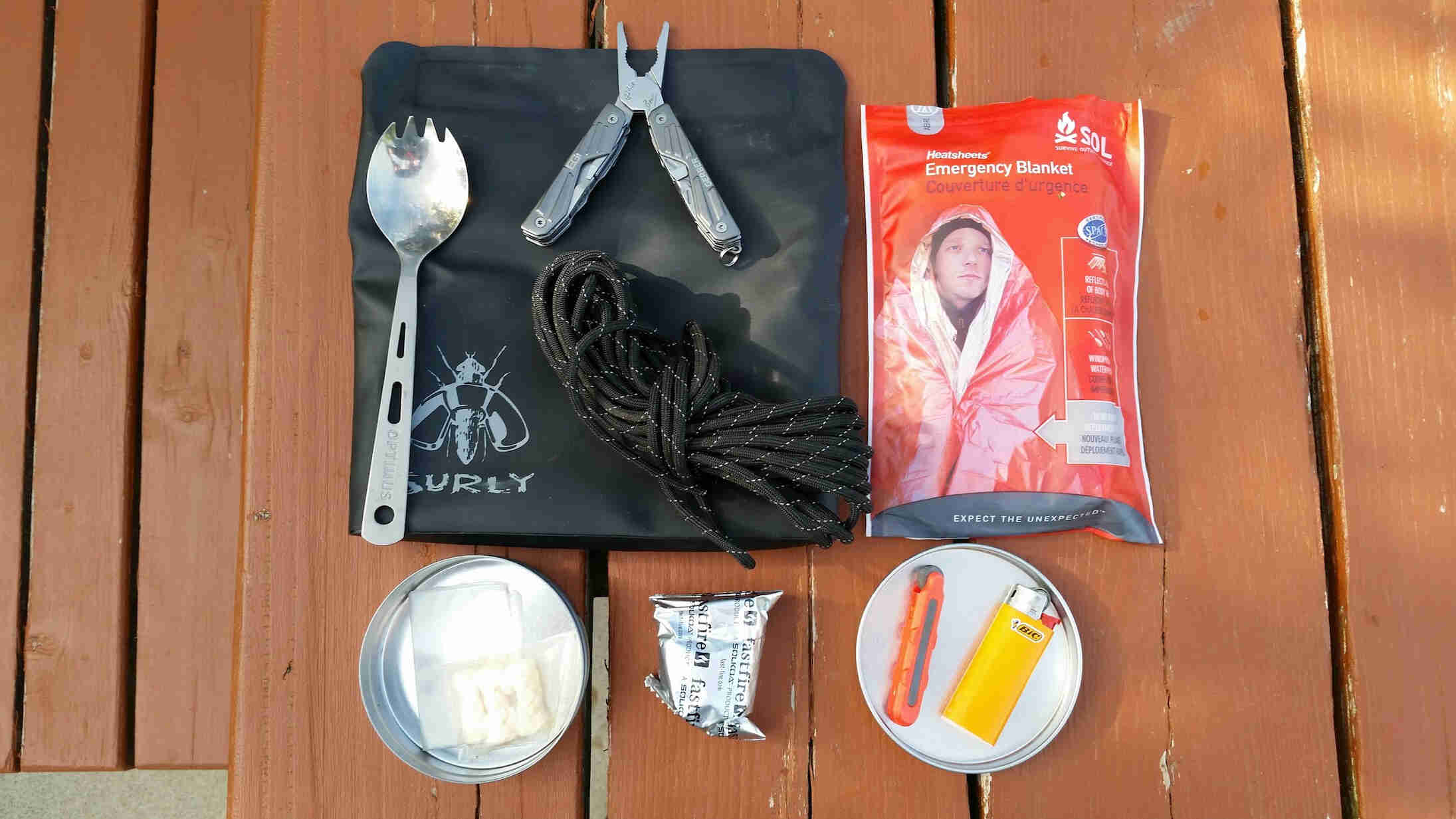 Downward view of fire starting supplies, on top of a wood picnic table