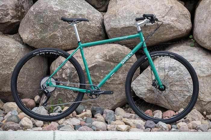 Surly bike leaning on boulders while wheels are on rocks