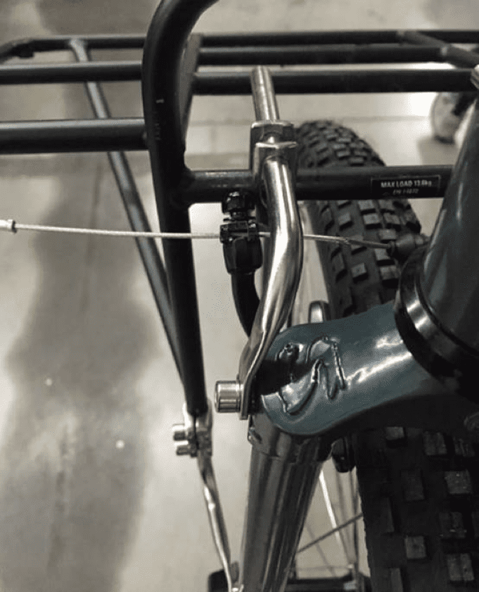 Downward left side view of a Surly Pack rack, mounted to the fork on a bike