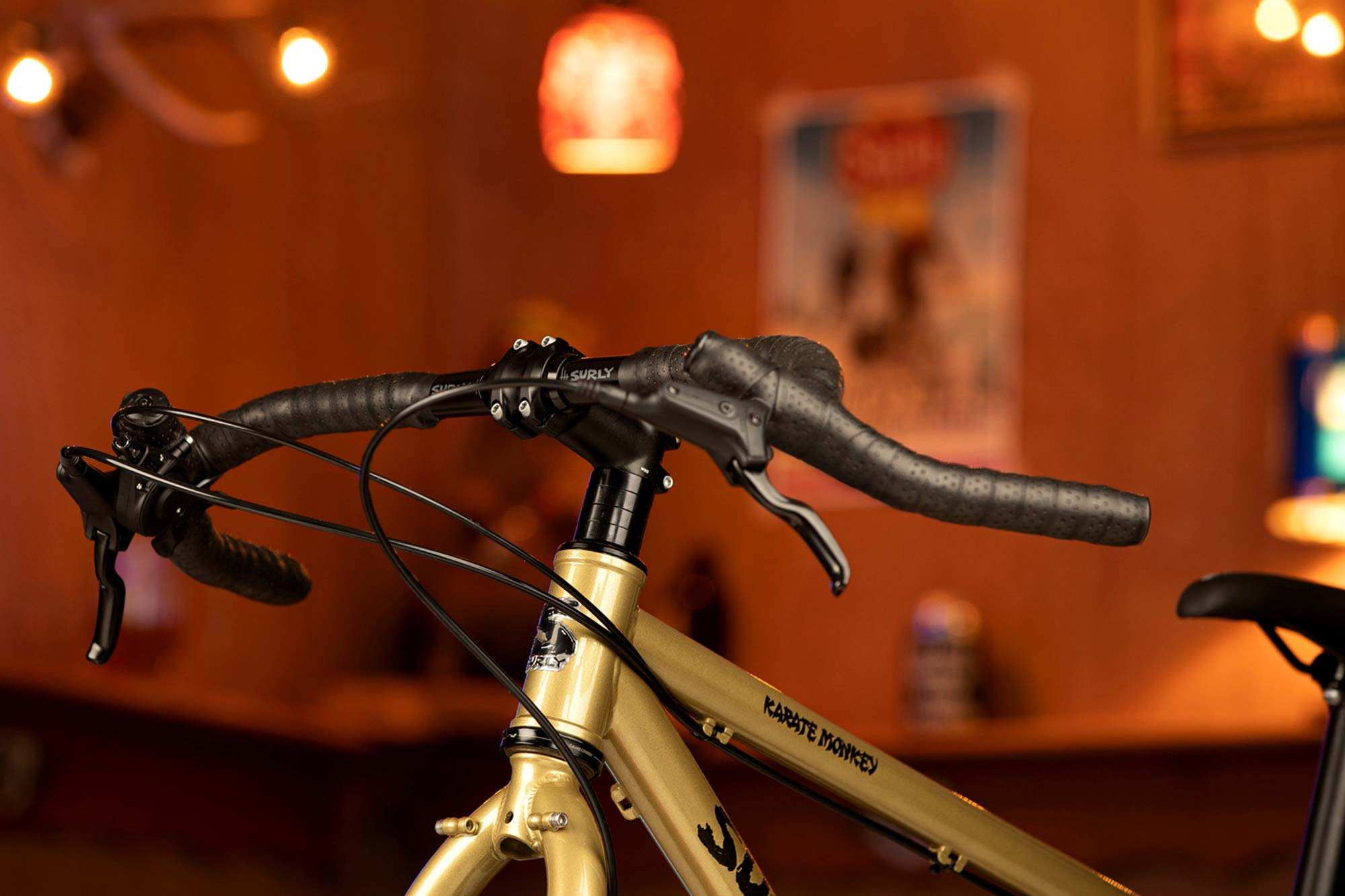 Surly Corner Bar wrapped with black bar tape on complete Surly Karate Monkey with mountain brake levers and shifter