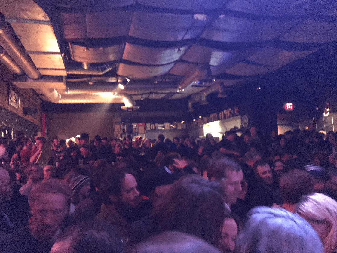 A dim room at the Triple Rock Social Club crowded with people