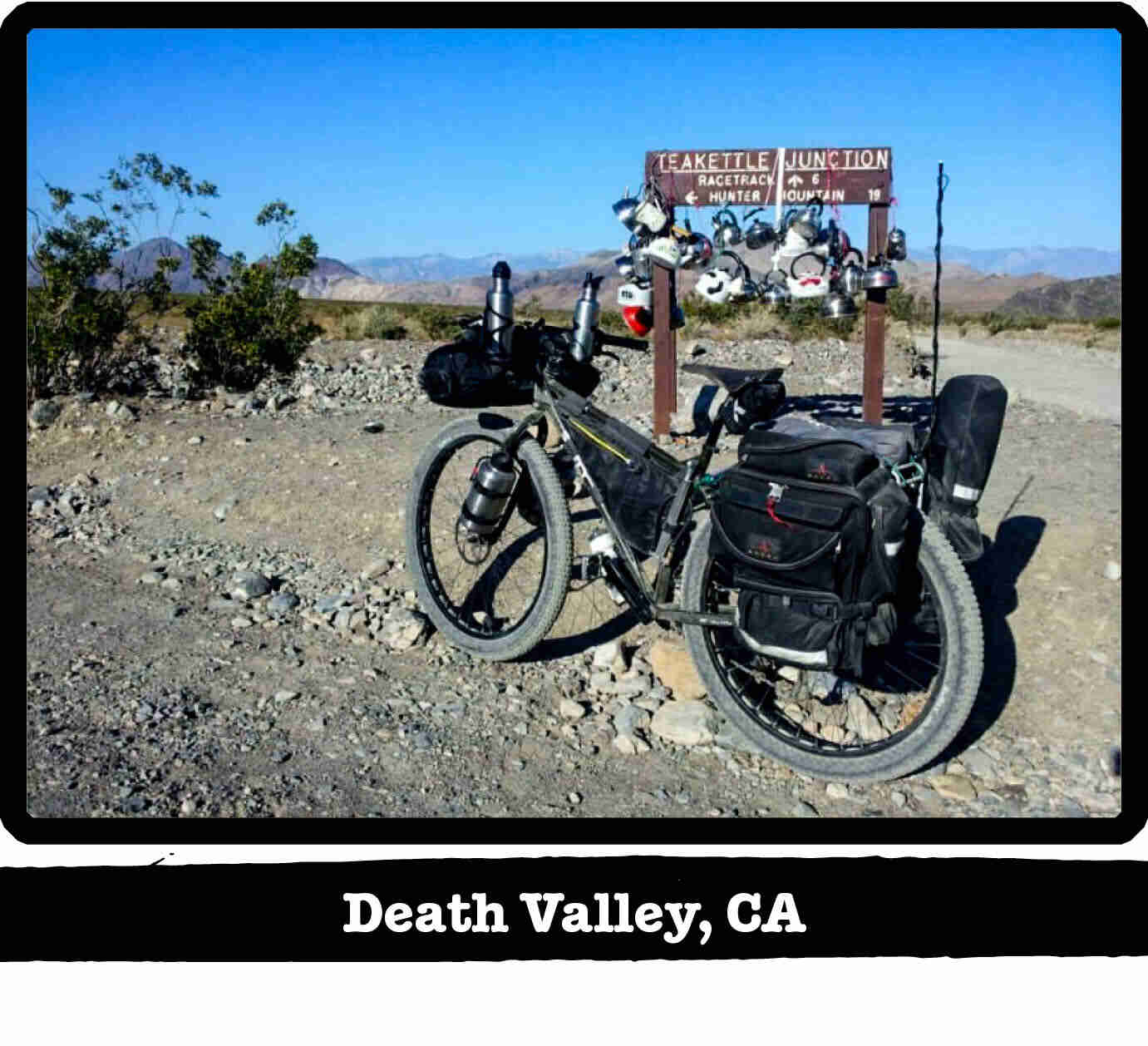 Left side view of a Surly ECR fat bike on a rocky trail, with hills in the background - Death Valley, CA tag below image