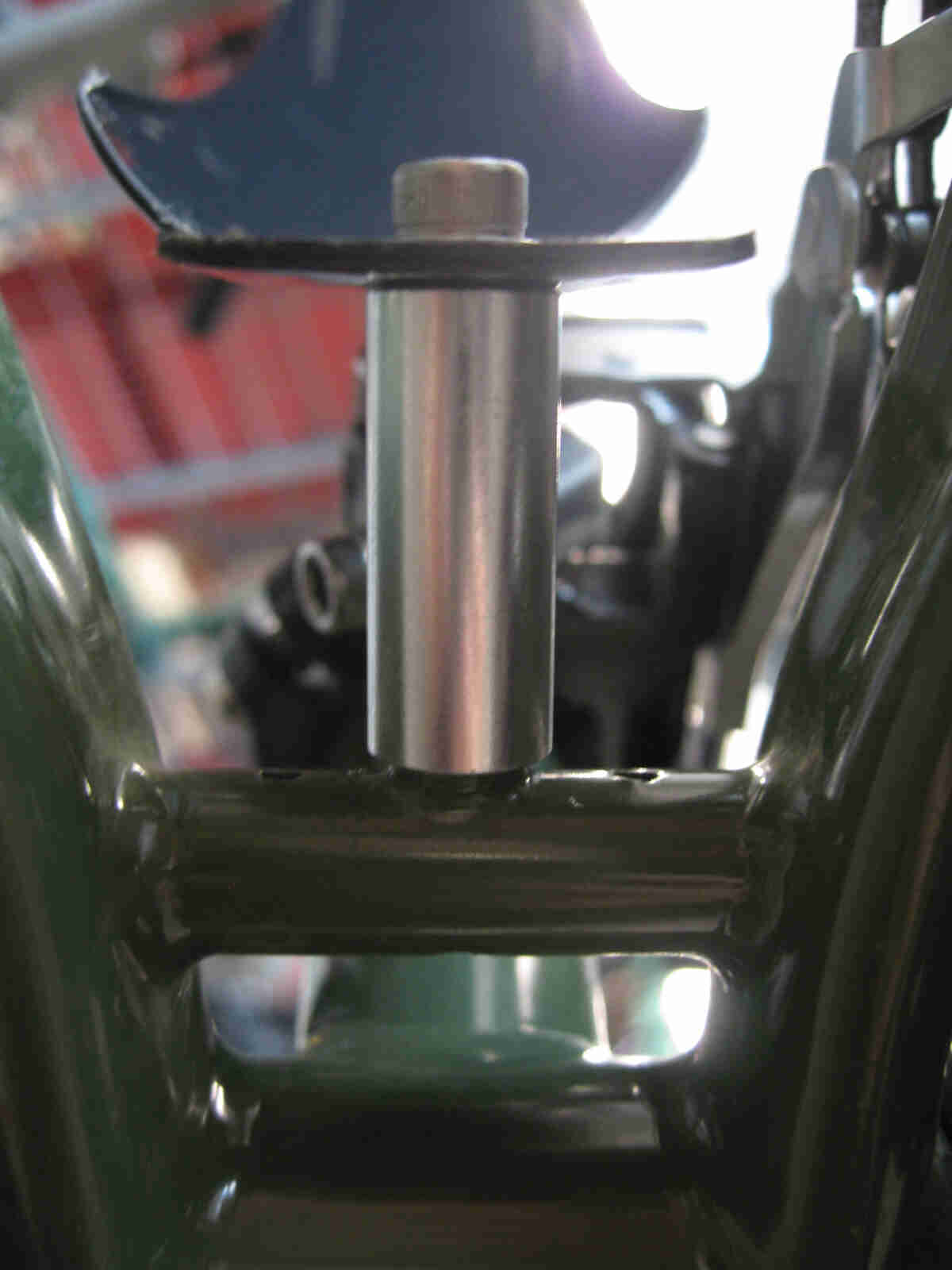 Surly Ogre bike - green - rear fender mounting bolt detail - underneath, close up view