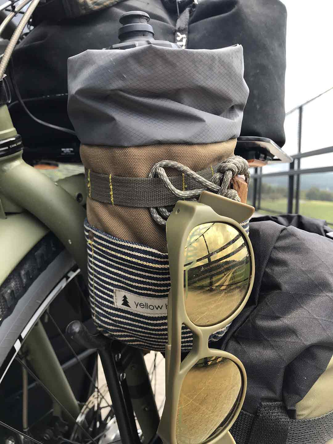 Water bottle bag with olive green mirrored sunglasses attached mounted to front bike fender