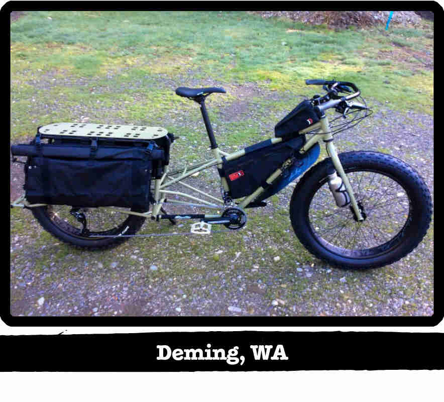 Right side view of a Surly Big Fat Dummy bike, olive, parked on gravel - Deming, WA tag below image