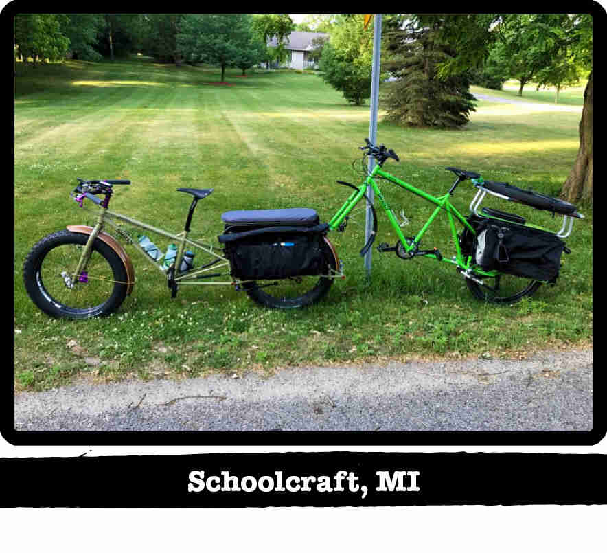 Left side view of a Surly Big Fat Dummy bike, green, with a bike attached to the back - Schoolcraft, MI tag below image