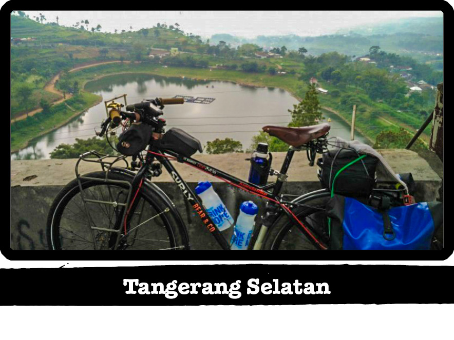 Left side view of a Surly Karate Monkey bike, black, with pond in background - Tangerang Selatan tag below image