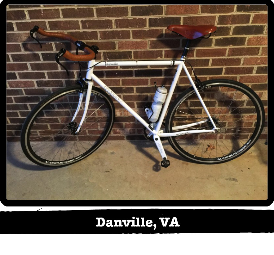 Left side profile of a while Surly bike leaning against a brick wall - Danville, VA banner under image
