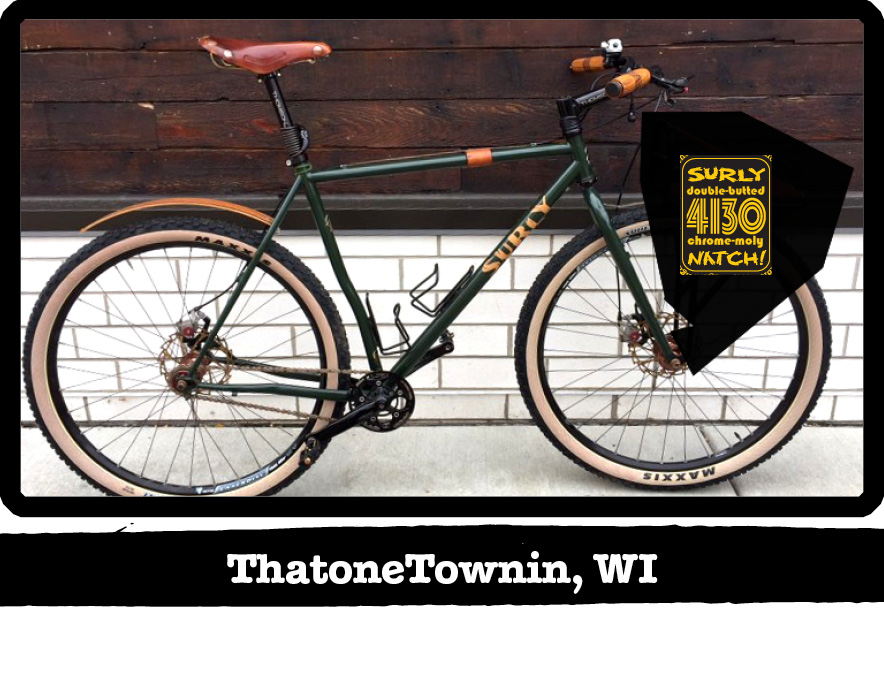 Right profile of a green Surly bike against a white brick and wood wall-ThatoneTownin, WI banner shown below image