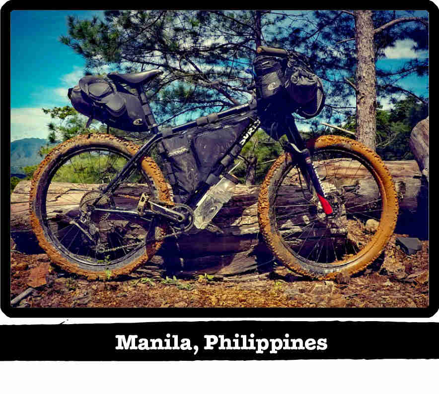 Right profile of a Surly Karate Monkey bike, black, with muddy tires - Manila Philippines tag below image