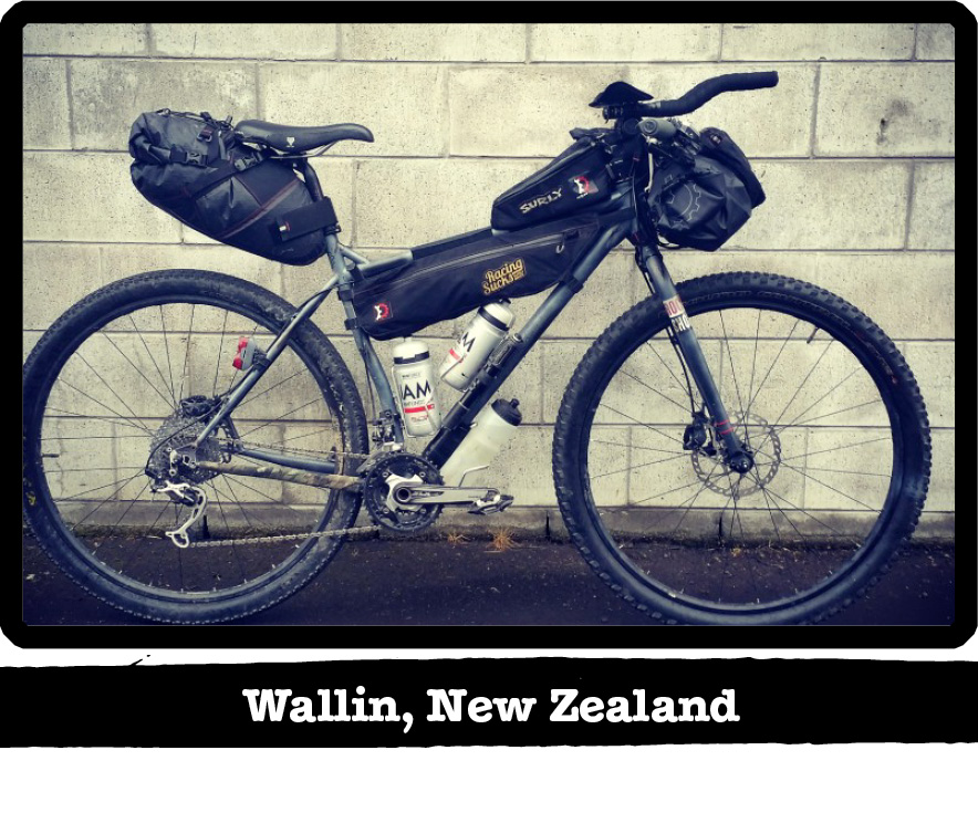 Right profile of a gray Surly bike on a sidewalk with a cinder block wall behind-Wallin, New Zealand banner below image