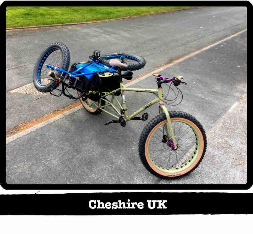 A Surly BIg Fat Dummy bike,green, on the side of a road with a fat bike laying on back - Cheshire, UK tag below image