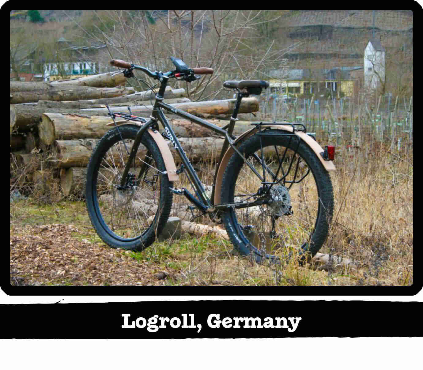 Left side view of a Surly ECR bike, with a pile of longs in background - Logroll, Germany tag below image
