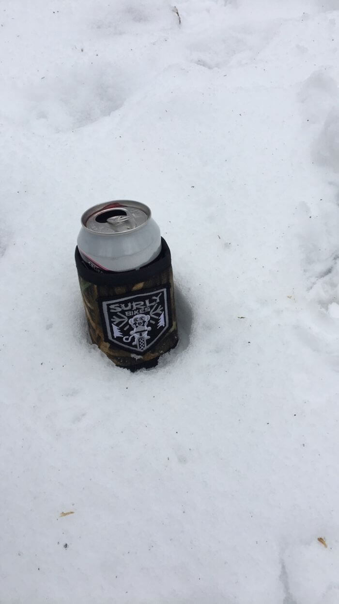 Can in a Surly can cooler in the snow