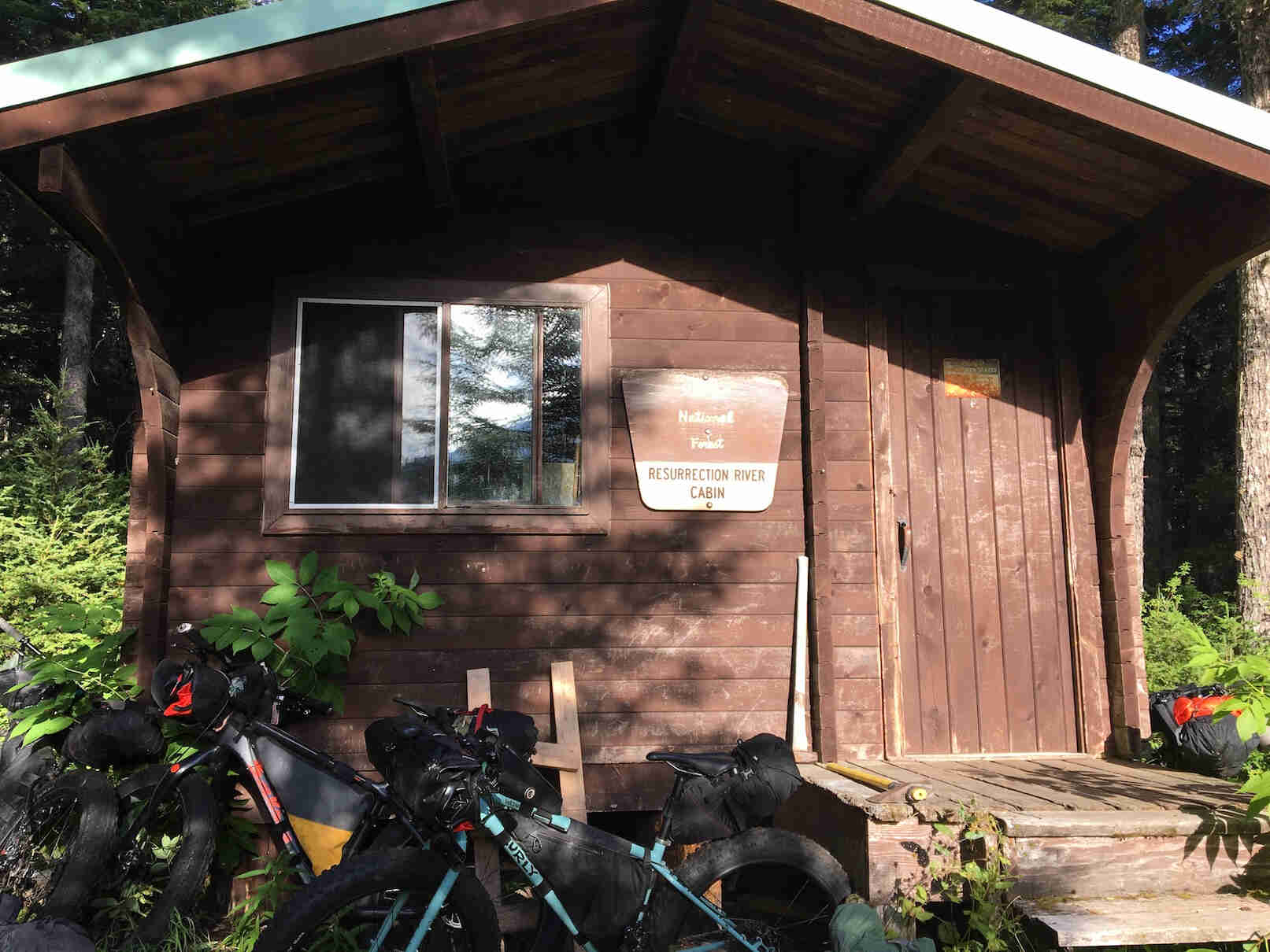 Fat bikes in front of the National Park Resurrection River cabin