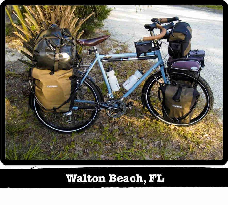 Right side view of a light blue Surly Long Haul Trucker bike, loaded with gear - Walton Beach, FL tag below image