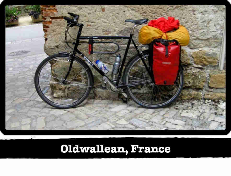 Left side view of a black Surly Long Haul Trucker bike loaded with gear - Oldwallean, France tag below image