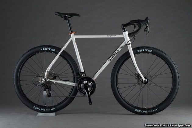 Right profile view of a Surly Midnight Special bike, white, against a gray background