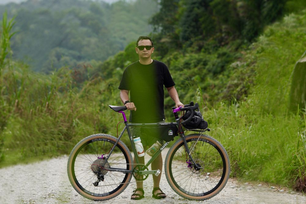 Hafis Hassan Standing with his Straggler Bike