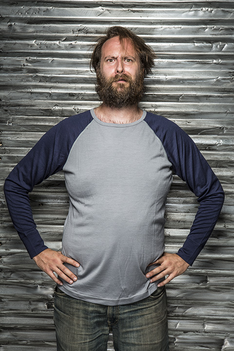 Front view of a person wearing a Surly Raglan long sleeve shirt - Gray with blue sleeves