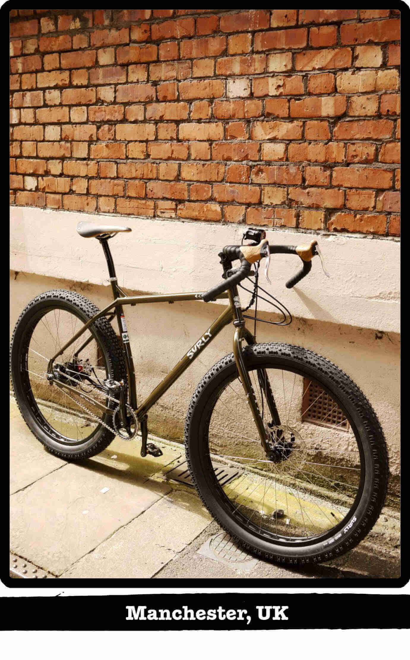 Right side view of a Surly ECR fat bike on sidewalk, leaning against a wall - Manchester, UK tag below image