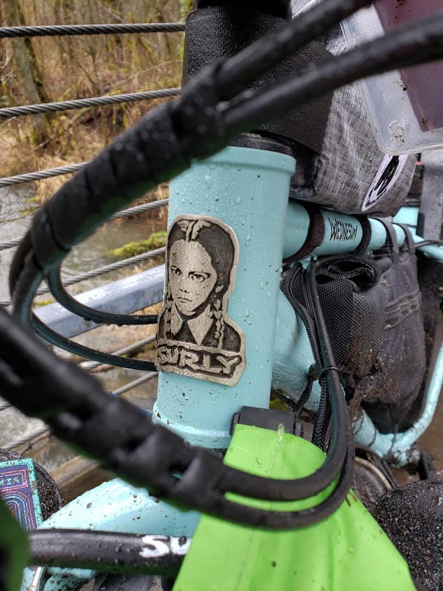 Front close up view of the head tube of a Surly Ice Truck fat bike with a Surly emblem showing Wednesday Adams