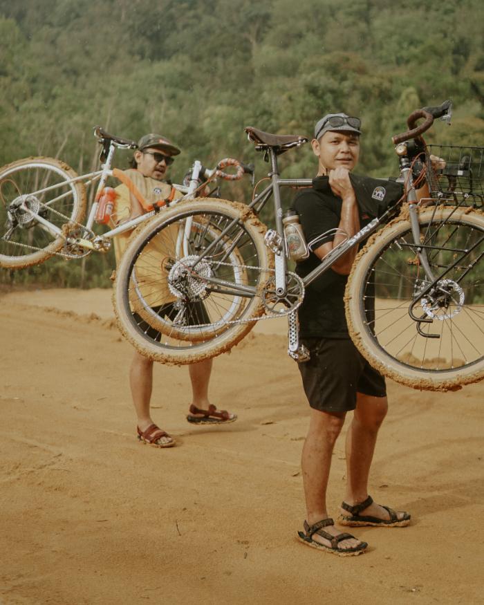 Hafis Shouldering His Bike