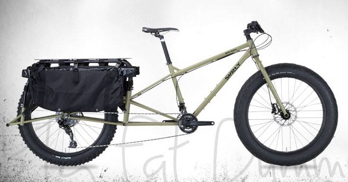 Right side view of a tan Surly Big Fat Dummy bike, with a white background behind
