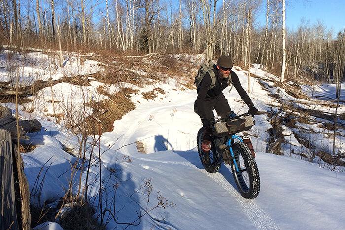 Rider Navigating a winter bike trail in snow
