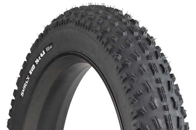Surly Bud 26 x 4.8 inch fat bike tire mounted on rim showing tread and sidewall with white hot patch on white background