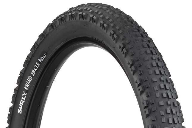 Surly Knard 29 x 3 inch tire mounted on rime showing tread and sidewall with hot patch on white background